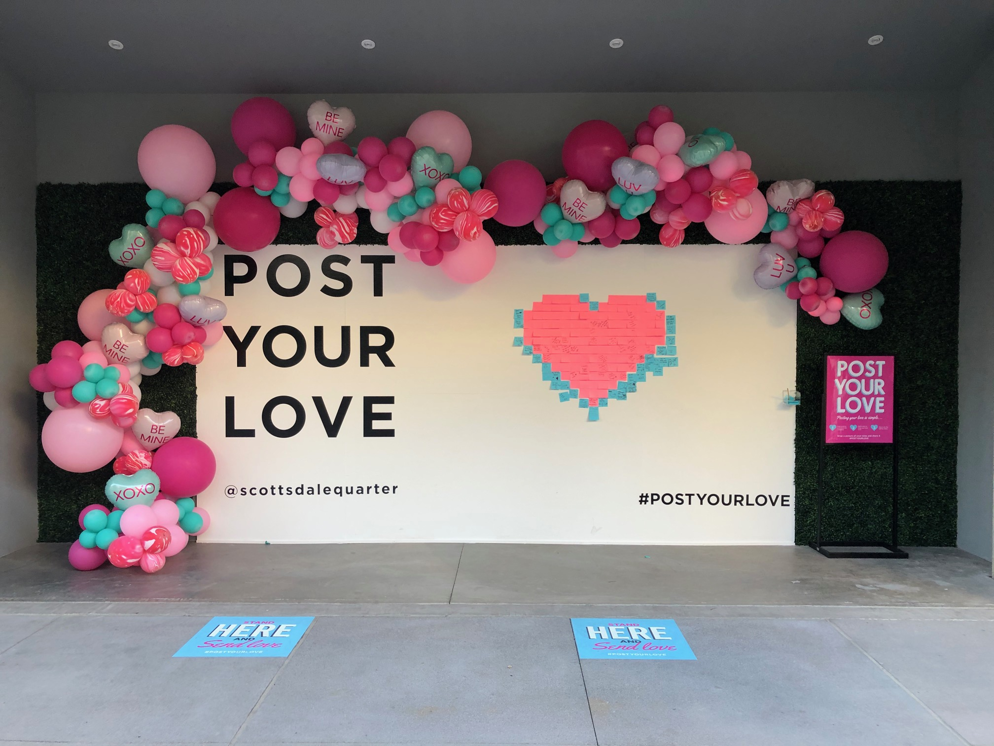 "Wall with balloons and ""Post Your Love"" graphic"